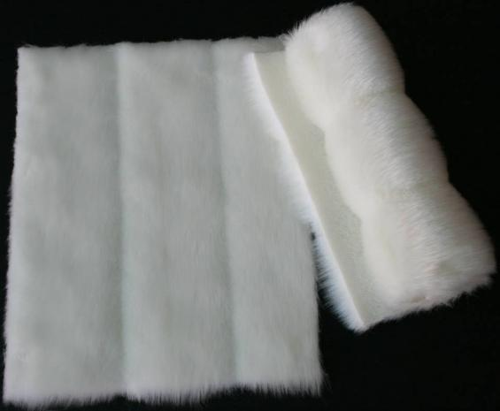 Detail faux fur fabric article mink color white