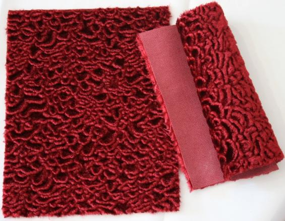 Detail faux fur fabric article astrakhan color red